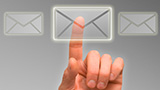 Image of a hand hovering over digitally imposed envelopes