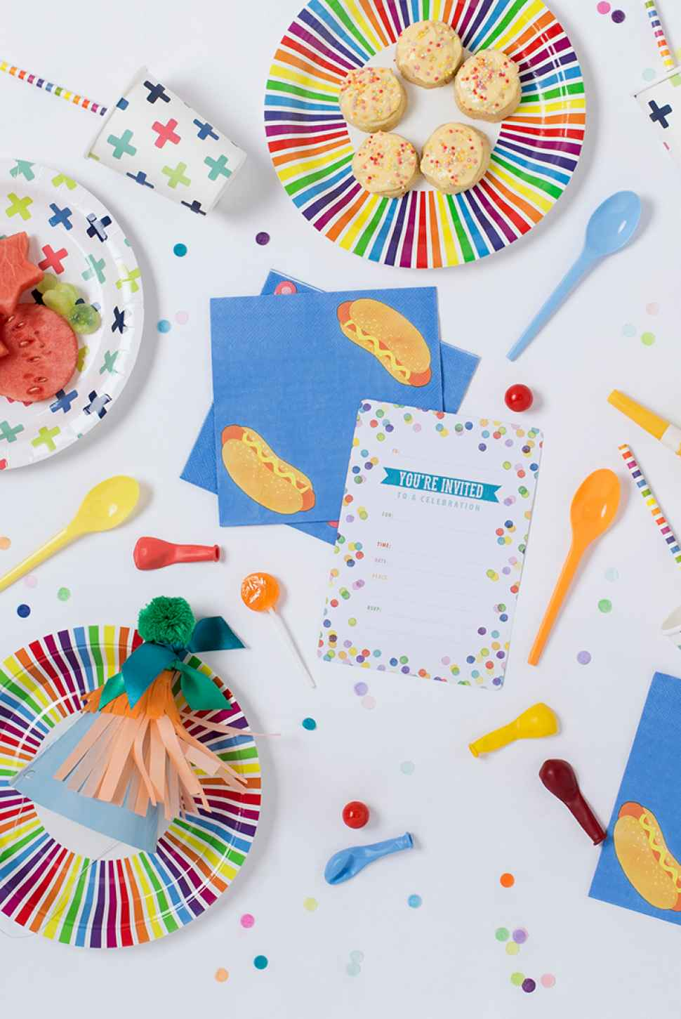 Colourful party invitation and paper plates.