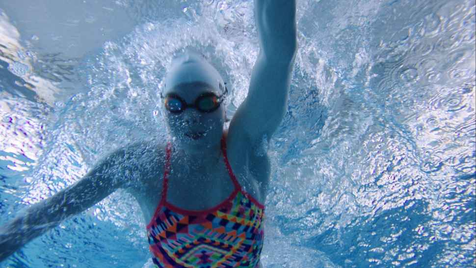 Underwater photo of Emily Beecroft in the swimming pool